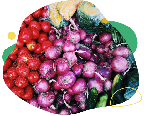 bunches of red onion, tomatoes and cucumbers
