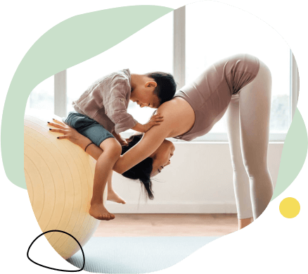 woman doing yoga with young boy